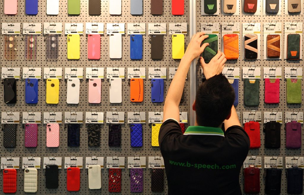 BERLIN, GERMANY - AUGUST 31: An employee arranges Apple iPhone cases at the at the D-Parts stand at the Internationale Funkausstellung (IFA) 2012 consumer electronics trade fair on August 31, 2012 in Berlin, Germany. IFA 2012 is open to the public from today until September 5. (Photo by Adam Berry/Getty Images)